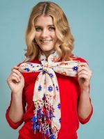 6 Genius Ways To Style Your Scarf #refinery29  http://www.refinery29.com/62881#slide-22  You can wear this style as loose or as tight as you prefer. We like having the knot positioned right at the breastbone, which showcases the pretty fan-like effect....