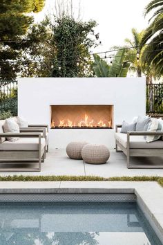 outdoor oasis backyard on a budget ~ outdoor oasis backyard ; outdoor oasis backyard with pool ; outdoor oasis backyard on a budget Outdoor Fireplace Designs, Backyard Fireplace, Modern Outdoor Fireplace, Modern Outdoor Living, Fireplace Wall, Contemporary Outdoor Fireplaces, Minimalist Outdoor Furniture, Fireplace Seating, Fireplace Inserts
