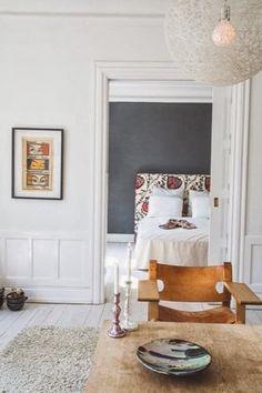 basement - light floors, white walls, wood furniture, charcoal gray accent wall, natural fibers