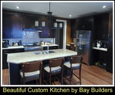 Open Concept, Modern Kitchen designed by Bay Builders