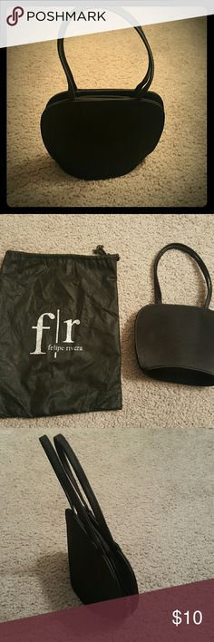 Felipe Rivera Black Evening Handbag with Strap A chic little black bag to go with your little black dress. It's big enough for your phone, keys, and credit card, and lipstick. In near-pristine condition, with one small and nearly imperceptible color imperfection (pictured). Comes with a protective bag. Felipe Rivera Bags Clutches & Wristlets