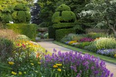 Gardens - Colourful summer borders in the gardens at Nymans, West Sussex.