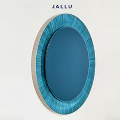 Blue Wave Mirror: the straw marquetry applied on a curved frame. Designed by Jallu, furniture makers, straw marquetry furniture, marqueterie de paille, blue furniture, made in France, luxury handmade furniture, luxury interiors, luxury interior design inspiration, luxury custom furniture, straw marquetry design, Jallu Creations 2021, modern luxury, bespoke furniture, French designer