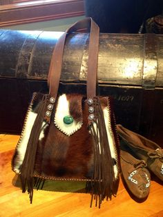Hair in hide purse with fringe. Lined.  All bags are custom made at gowestdesigns.us. See you there!