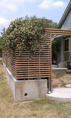 Horizontal slats with poured concrete base.