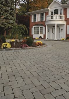 This driveway is made with Cambridge Pavingstones' permeable pavers, which means that all rain water is filtered through the system before it enters nearby streams and rivers.