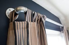Pipe Curtain Rods. Great idea for a star wars themed bedroom or just to get that industrial look.