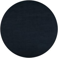 Hand-crafted in wool, this rug features colors of dark slate blue. This rug is the perfect addition to any home.