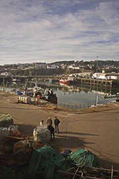 Fishermen in Fishing Harbour, Dunmore east, County Waterford, Ireland by Panoramic Images