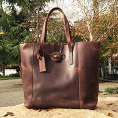c315bfa596  Item ships free  Distressed dark chocolate baseball glove leather brings  this tote to the forefront of off the field baseball style.