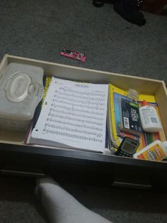 Organized the Draw filled with school supplies and  a  sheet music ode to joy from symphony No .9  (violin 2)