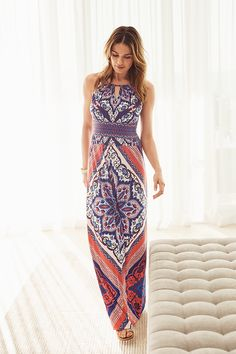 A vibrant scarf print makes a dramatic statement across this modern maxi dress, finished with a keyhole neckline.
