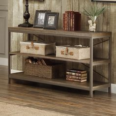 A continuous metal frame comprises the support system in the Helene Collection. With a weathered wood table top, with hints of gray within the finish, lending distinct character. This rustic occasional offering will be the centerpiece to your casual living space.