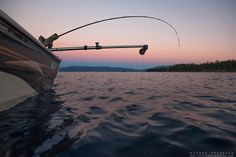 """""""Sunset Fishing on Lake Tahoe 9"""" - Photograph of a fishing pole and downrigger at sunset on Lake Tahoe, on the East Shore."""