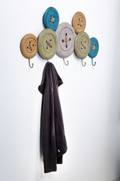 For my someday sewing room  You could make this by painting Frisbees & adding laces to the center then put a board behind them for stability.