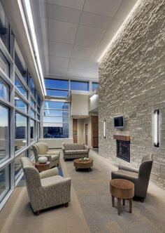 Natural daylight, stone walls, fireplaces, and translucent polymer privacy partitions are among the hospital's nature-inspired features. Photos courtesy of HDR Architecture, Inc.; © 2011 Tom Kessler.