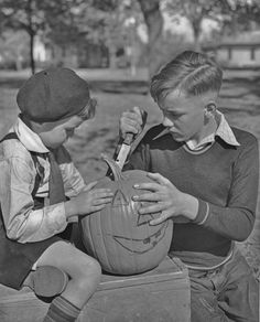 Two youngsters carving a Halloween jack-o-lantern, 1950s. #vintage #1950s #pumpkins
