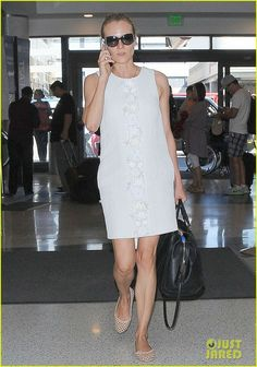 Diane Kruger chats on the phone while arriving for a departing flight at LAX Airport on Saturday (September 13) in Los Angeles.
