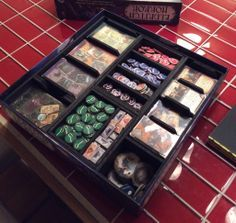 Foamcore storage solution for Eldritch Horror. All trays inside.
