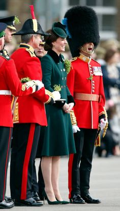 Catherine Duchess of Cambridge presents shamrocks to soldiers of the Irish Guards as she attends the annual St Patrick's Day Parade at Cavalry...