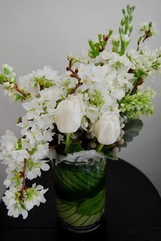 taller white and green arrangement