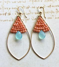 Hey, I found this really awesome Etsy listing at http://www.etsy.com/listing/80449299/peach-aqua-hoop-earrings-peach-coral