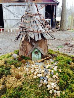 Miniature Grape Fairy House Fairy House I made from a stump, bark from a Cherry tree and grape vines. I used moss from around my yard for the lawn and dollar store stones for the walkway. Fairy Garden Houses, Gnome Garden, Fairy Gardens, Fairies Garden, Landscaping Around Trees, Backyard Landscaping, Silver Maple Tree, Fairy Tree, Gnome House
