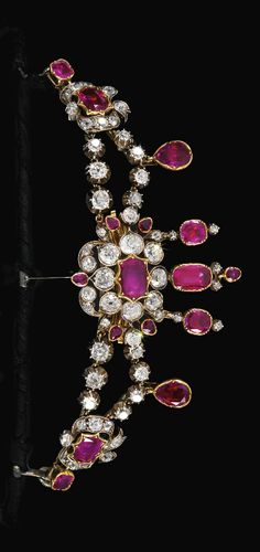 A Victorian ruby and diamond tiara, mid-19th century. Set with foil backed rubies and circular-cut and rose diamonds, length approximately 370mm, may be worn as a necklace with a detachable chain, additional brooch fittings, inner circumference of tiara approximately 180mm, fitted case. #antique #Victorian #tiara