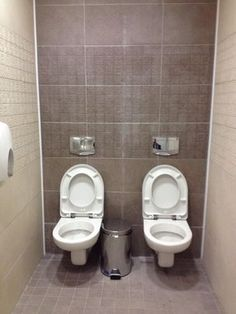 A BBC photo of a men's cubicle with twin toilets at a Sochi Olympics venue has caused a Twitter storm in Russia.