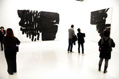 People watch paintings by French artist Pierre Soulages presented during an exhibition at the Centre Pompidou in Paris. Photo by Fred Dufour/AFP/Getty Images Art Beat, What To Draw, Space Gallery, Exhibition Space, Art Abstrait, French Artists, Op Art, Dark Colors, Where To Go