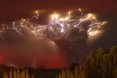 Lightning flashes around the ash plume above the Puyehue-Cordon Caulle volcano chain near Entrelagos June 5, 2011. The volcano in the Puyehue-Cordon Caulle chain, dormant for decades, erupted in south-central Chile on Saturday, belching ash over 6 miles (10 km) into the sky, as winds fanned it toward neighboring Argentina, and prompted the government to evacuate several thousand residents, authorities said. (REUTERS/Carlos Gutierrez)
