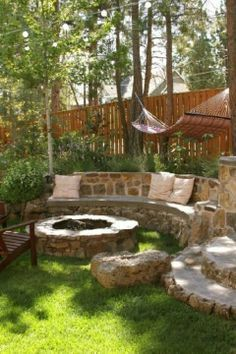Idea for a sloped back yard fire pit area More