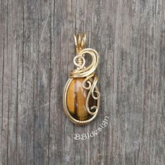 Tigereye Gemstone teardrop brass gold wire wrapped cabochon pendant Tiger's Eye swirl
