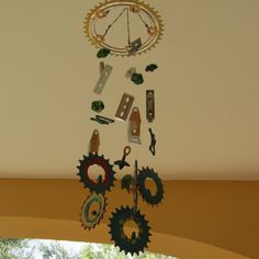 Windchime made from recycled bicycle parts and other metal parts and beads.Exclusive Handmade,Painted Art Mobile for Porch or Workshop .