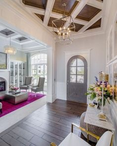 Entryway. Arched front door. Tons of natural light. And that plum colored rug is beautiful. Just the right pop of color.