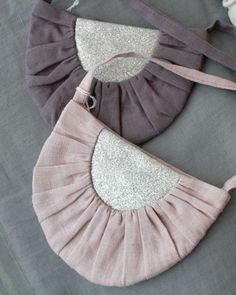 a larger semi-circle purse with slightly ruffled fabric trimming it would also be goodly doable.
