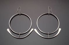 """Art Smith. ca 1950. Silver. One of the leading modernist jewelers of the mid-twentieth century, Smith trained at Cooper Union. Inspired by surrealism, biomorphicism, and primitivism, Art Smith's jewelry is dynamic in its size and form. Although sometimes massive in scale, his jewelry remains lightweight and wearable. See """"From the Village to Vogue: The Modernist Jewelry of Art Smith""""."""