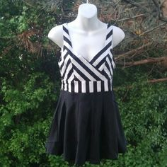 """~Stripe Out~ This flirty sleeveless combination romper features a striped bodice, v-neckline and contrasting solid shorts with flouncy fit.  Fabric Content: 100% COTTON Description: L: 28"""" B: 14"""" W: 13""""  ~I SELL OTHER PLACES SO ITEMS GO QUICK SO DON'T HESITATE AND MISS OUT~ Dresses"""