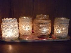 1. Cover mason jars with lace 2. Spray frosting paint over lace 3. Remove lace 4. Place candle inside and enjoy - pretty diy decor! pyssen-strube-wedding but with wine bottles