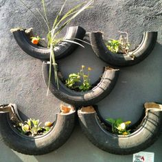 Wall planters made of recycled tires.