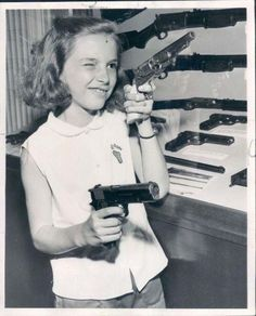 That revolver looks fake, but I wouldn't take a chance on that Colt 1911 in her right hand. Revolver, Women Shooting Guns, Baby Shots, Cool Guns, Poses, Guns And Ammo, Vintage Photos, Vintage Photographs, Funny Pictures