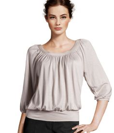 Top in slightly glossy jersey with a shirred scoop neckline, 3/4-length sleeves and a ribbed hem. Button at back neck.