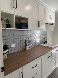 White shaker cabinets, grey subway tile splashback (or marble) and timber bench top. Grey Kitchen Tiles, Kitchen Splashback Tiles, Timber Kitchen, White Shaker Kitchen, White Shaker Cabinets, Kitchen Benches, Kitchen Tops, New Kitchen, Kitchen Design