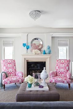 Love the turquoise accents and the pink and white chairs!! #pink chairs, #turquoise, #Living Room