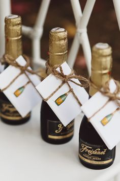 An Elegant DIY Partyscape...Mini bottles of champagne on a Drink cart or at the Bar with a set of note-cards tied to them served as favors for our guests.