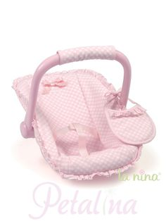 La Nina Pink Check Maxi Cosy Baby Doll Car Seat. A gorgeous baby doll car seat designed by La Nina in Spain. Suitable for children age 3+. The car seat has the pretty white and pink check fabric on all the La Nina baby products for 2013. The fabric has an easy wipe sheen finish to it, and the cover can be easily removed to be washed. The baby doll car seat has pink straps to hold the baby doll in place, and a pink bow at the top of the seat for decoration.
