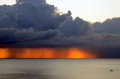 """Bright Orange Glow Of Sun Setting Behind Thunderstorm in Palermo, Sicily, ITALY: photo credit: © Francesco Paolo Caruso""  *** it's mesmerizing.  It looks like a fire with thick clouds of smoke over it."