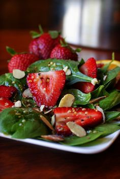 Spinach-Strawberry Salad:  Delectable Dressing:  2 tablespoons each: olive oil, apple cider vinegar, organic sugar,   1 tablespoon each: sesame seeds, tamari (or soy sauce), orange juice,   ½ tablespoon poppy seeds,   ⅛ teaspoon paprika -     Salad:  One 5 oz. bag of baby spinach,   1 pint strawberries, trimmed and thinly sliced -   Topping:  ½ cup sliced almonds, toasted