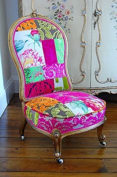 upholstered antique sofas chairs chaise lounge.  Love this image; love the combo of patchwork with the French armoire in the background.