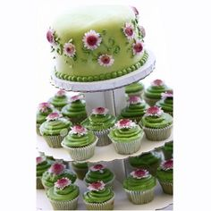 "Cupcake wedding cakes are a great alternative to traditional wedding cakes. These wedding ""cakes"" are really just cupcakes displayed . Pretty Cakes, Cute Cakes, Beautiful Cakes, Amazing Cakes, Green Cupcakes, Green Cake, Cupcake Tower Wedding, Wedding Cakes With Cupcakes, Tea Cupcakes"
